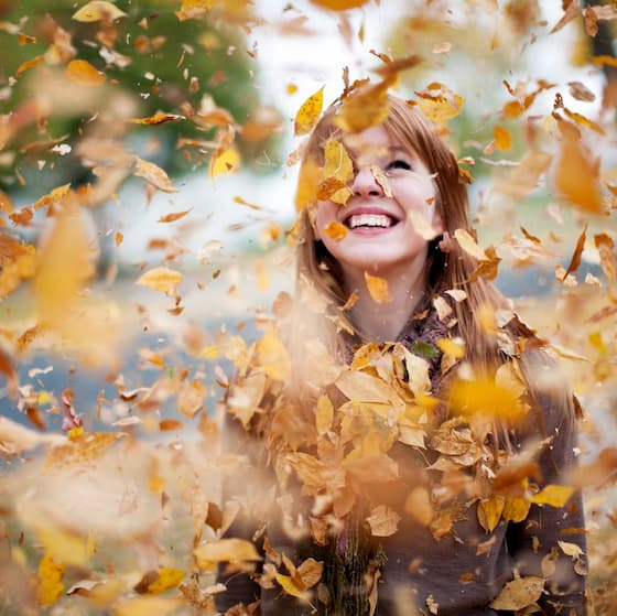 redheaded-girl-in-cloud-of-leaves-high-res-stock-photography-157494477-1537469696